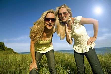 sisters wearing yellow top and jeans in the summer Stock Photo - 3305194