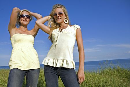 sisters wearing yellow top and jeans in the summer Stock Photo - 3305189
