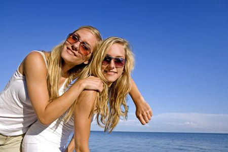 sisters wearing yellow top and jeans in the summer Stock Photo - 3305188