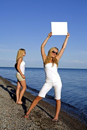 sisters holding white sign in the summer day Stock Photo - 3305193
