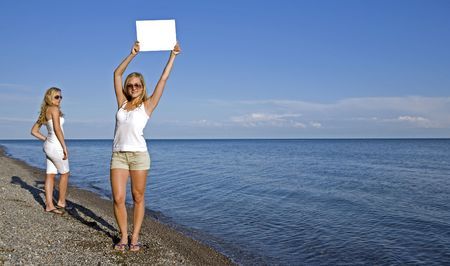 sisters holding white sign in the summer day Stock Photo - 3305187