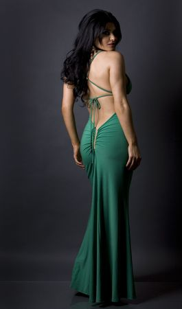 pretty glamour model wearing green dress in studio