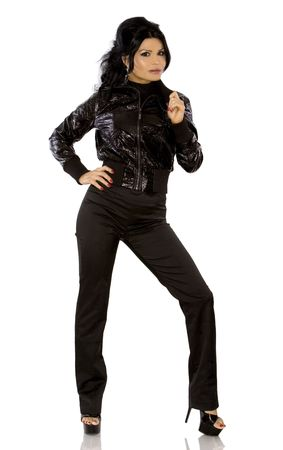 winter fashion: pretty woman wearing black outfit on white background