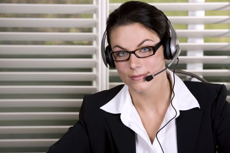 pretty business woman wearing headhset and the glasses Stock Photo - 3805129