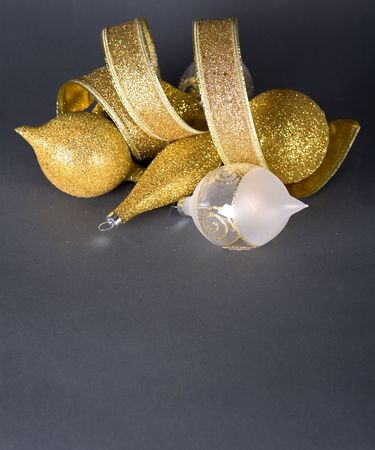 xmas background: beautiful gold seasonal Christmas decorations on dark background Stock Photo
