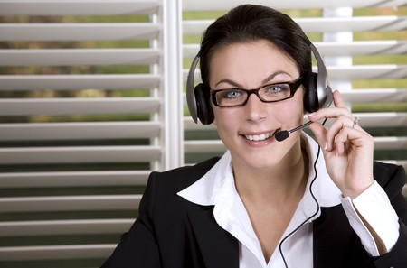 pretty business woman wearing headhset and the glasses photo