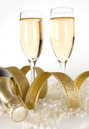 beautiful glass filled with gold champagne white background