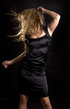 sexual activities: pretty woman moving dancing on the black background