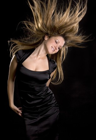 pretty woman moving dancing on the black background