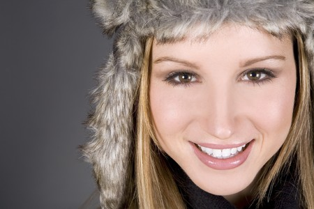 pretty woman smilling wearing fur outfit on grey Stock Photo - 4082966