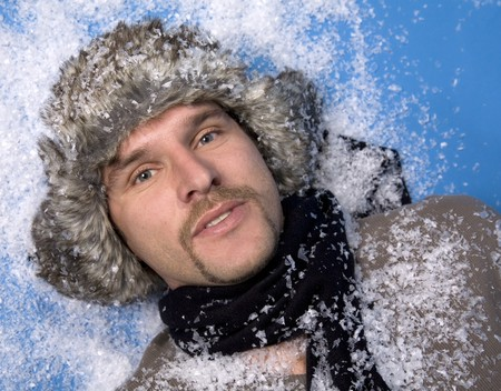 russian hat: russian man wearing fur with snow on blue