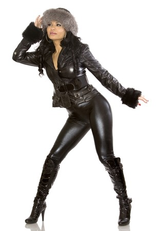winter woman: pretty model wearing leather outfit on white background