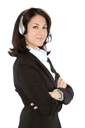 mooie vrouw met behulp van de hoofdtelefoon op een witte achtergrond geïsoleerd