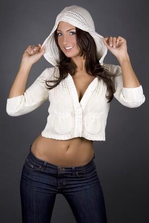 pretty brunette woman wearing white top on grey