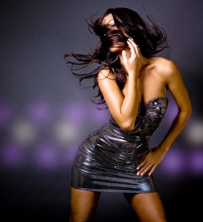 pretty fashion model having fun in the wind