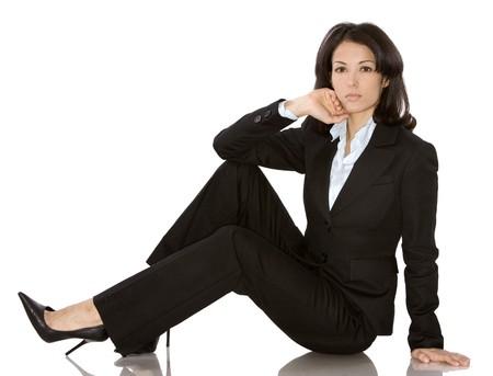 business woman wearing dark suit on white background Standard-Bild