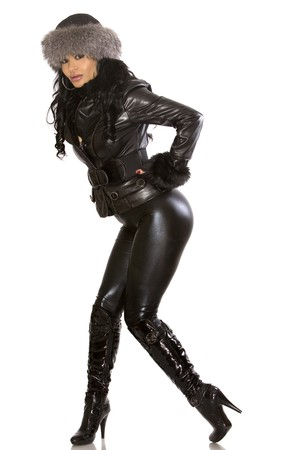 pretty model wearing leather outfit on white background photo
