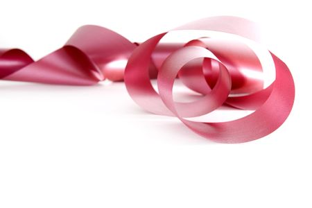 long pink ribbon curled up on white background Stockfoto