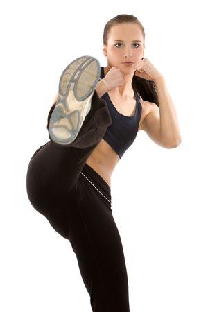 Mooie brunette model draagt sport outfit op wit Stockfoto - 4642115