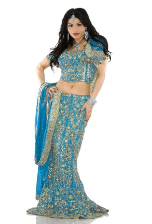 indian blue: pretty brunette wearing traditional indian outfit on white
