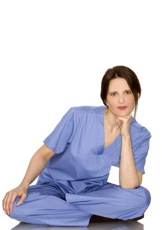 pretty brunette nurse standing on white isolated background photo