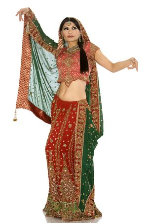 exotic dancer: beautiful indian woman wearing bridal outfit on white