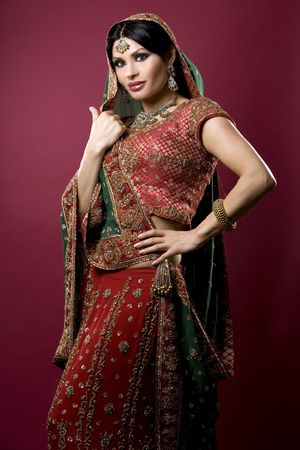 middle eastern clothes: beautiful indian woman wearing bridal outfit on red