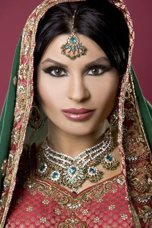 middle eastern clothing: beautiful indian woman wearing bridal outfit on red
