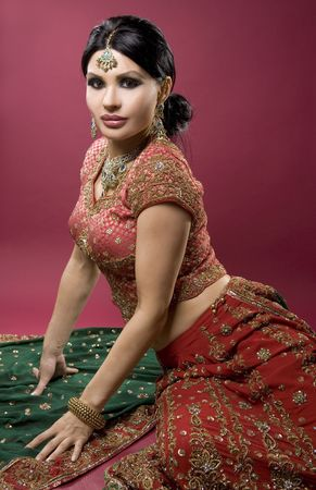 beautiful indian woman wearing bridal outfit on red Stock Photo - 5556372