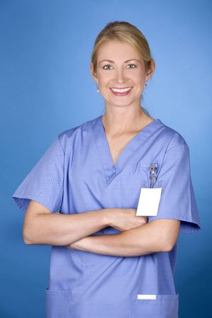 beautiful blond healthcare worker wearing blue uniform scrubs Stock Photo - 5580557