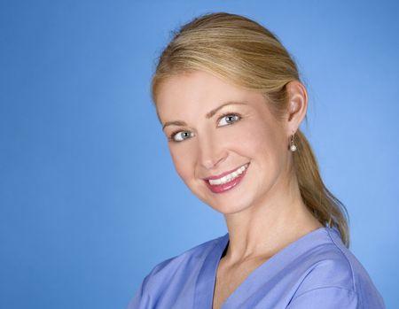 beautiful blond healthcare worker wearing blue uniform scrubs Stock Photo - 5580571