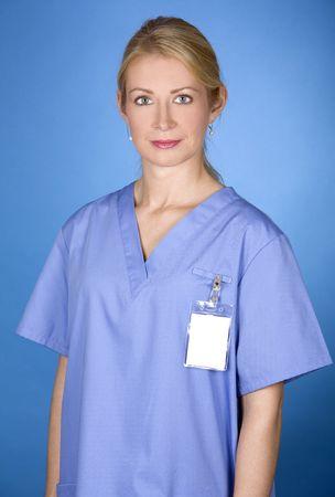 beautiful blond healthcare worker wearing blue uniform scrubs Stock Photo - 5580560