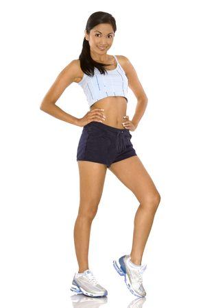 Jolie brunette portant costume sport sur fond blanc Banque d'images - 5581601