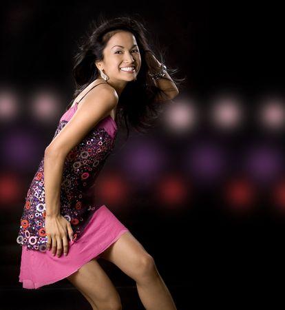 pretty brunette woman having fun on black background Stock Photo - 5581609