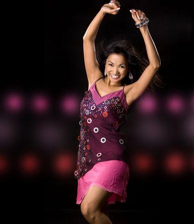 pretty brunette woman having fun on black background Stock Photo - 5581627