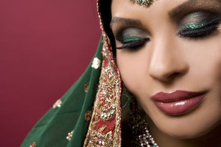 beautiful indian woman wearing bridal outfit on white photo