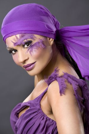 pretty brunette wearing purple outfit and matching makeup photo