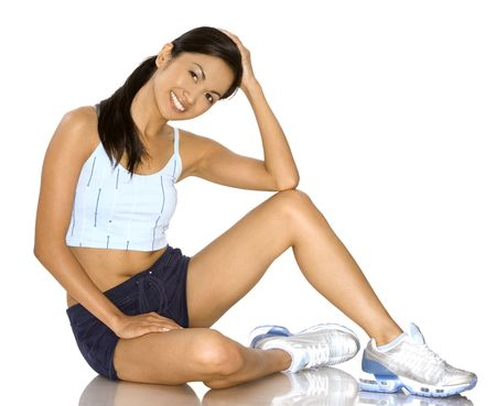 pretty brunette wearing sport outfit on white background Stock Photo