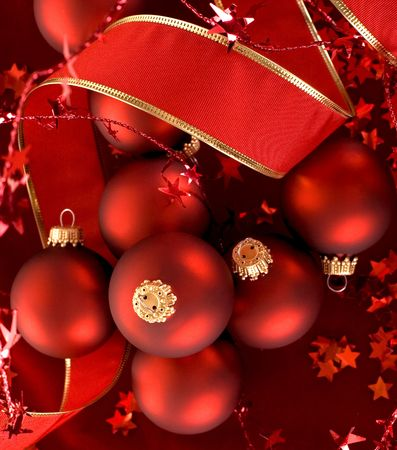 beautiful red ornaments on dark red velvet background Stock Photo