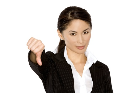 asian business woman holding her thumb down on white Stock Photo