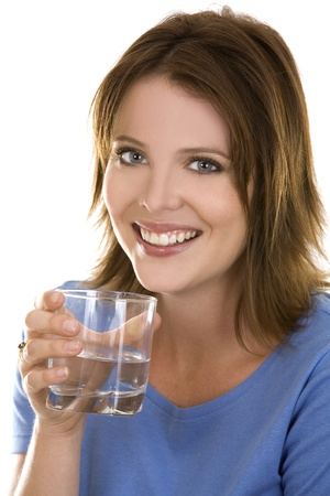 pretty casual brunette wearing blue top holding glass of water Reklamní fotografie