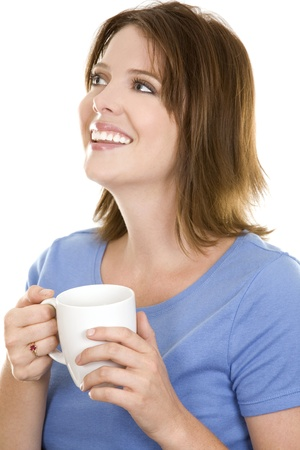 pretty casual brunette wearing blue top holding cup of coffee photo
