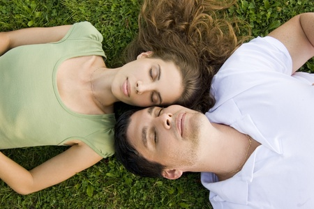 couple in the park relaxing on their backs Stock Photo - 10421906