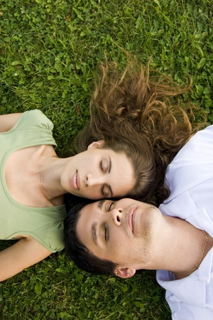 couple in the park relaxing on their backs Stock Photo - 10421907