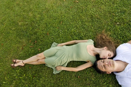 couple in the park relaxing on their backs Stock Photo - 10421914