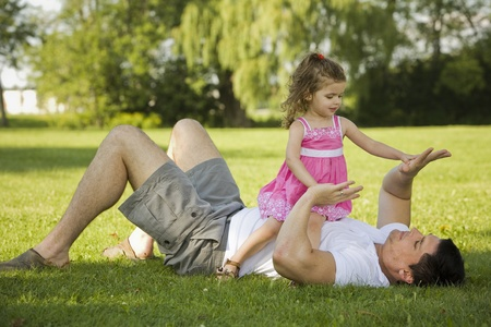 father with his daughter outdoors playing together Stock Photo - 10444397