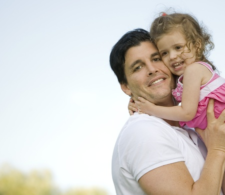 father with his daughter outdoors hugging together Stock Photo - 10444391