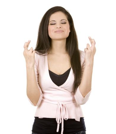 fingers: beautiful brunette crossing her fingers