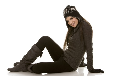 white winter: beautiful brunette wearing winter outfit on white background