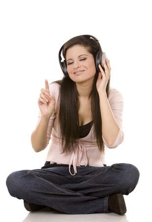 beautiful brunette listening to music on white background Stock Photo - 12176925